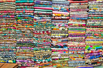 Colored textile in a traditional east bazaar in Vietnam.