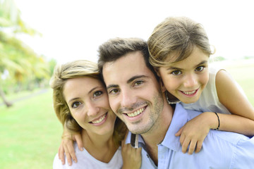 Portrait of happy family standing in park