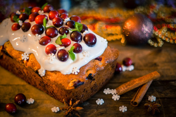 Cranberry cake on wooden table-traditional christmas bakery