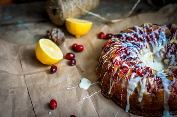Round lemon cranberry glazed cake on the paper -thanksgiving and