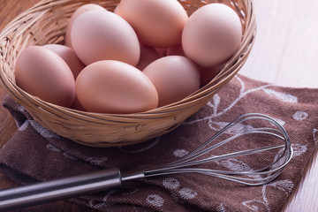 Chicken eggs in bowl  on wooden background