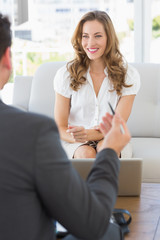 Smiling woman in meeting with a financial adviser