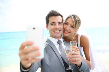 Married couple taking picture with smartphone