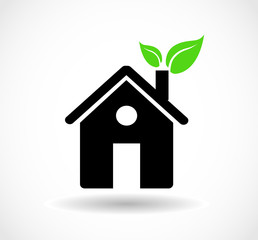 Eco house icon with green leaves in the chimney vector