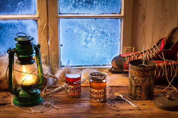 Fototapete - Hot tea in a small house at winter