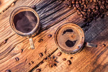 Fototapete - Closeup of hot coffee in old wooden table