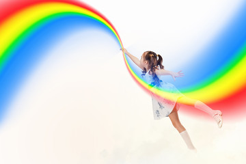 Little girl drawing rainbow