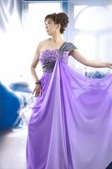 Garden Poster girl in a luxurious bright purple wedding dress