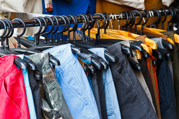 In de dag Alpinisme Colors of rainbow. Variety of casual trousers on hangers