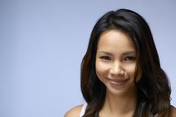 Portrait of Asian girl looking at camera and smiling