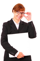 Mature red haired businesswoman with white office folder