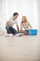 couple in new house choosing colors for walls