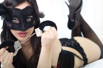 sexy young woman in sexy lingerie  holds handcuffs