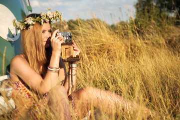 attractive woman taking pictures with an old camera