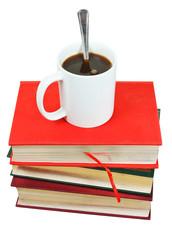 mug of coffee on stack of books
