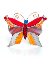 Handmade stained glass butterfly isolated on white