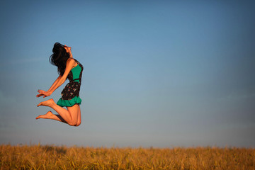 happy young girl in a field  levitation, flying happiness