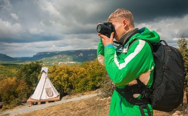 Young man makes outdoor shots