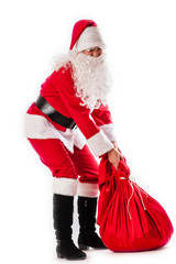 Santa Claus and a heavy bag with gifts
