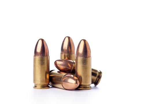 A group of 9mm bullets for a a gun isolated on white