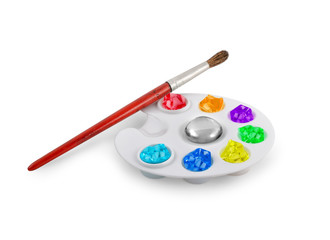 palette with a brush and paints