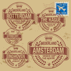Grunge rubber stamp set with names of Netherlands cities