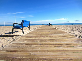 beach with boardwalk and benches