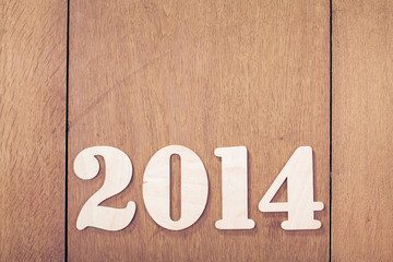 New Year date on wood background