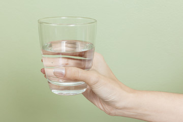 Woman hand with glass of water
