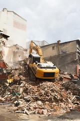 demolition excavator in the e city