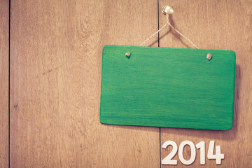 New Year date and signboard front wooden background