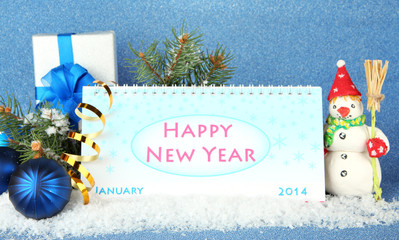 Calendar, New Year decor and fir tree on blue background