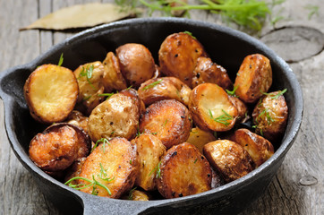 Roasted potato in a frying pan