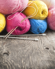 Yarn on wooden background. Selective focus
