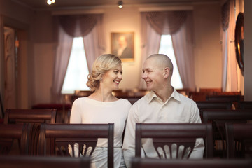 beautiful young man and woman sitting