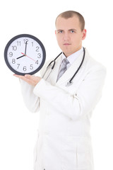 young male doctor holding clock isolated on white