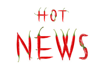 HOT NEWS text composed of chili peppers. Isolated on white backg