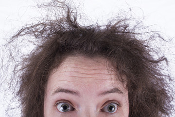 Top Half of Surprised Frizzy Haired Girls Head