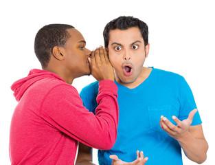 portrait guy whispering into man's ear telling him secret