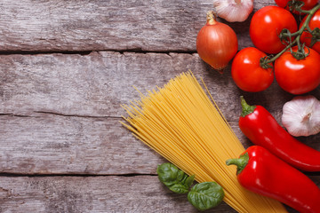 Ingredients for pasta: spaghetti, vegetables on an old table