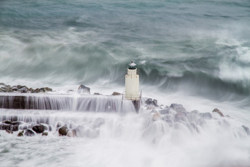 the lighthouse of Camogli during a storm