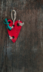 Red wooden heart on old vintage board