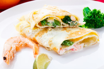 Omelet with shrimps and vegetables