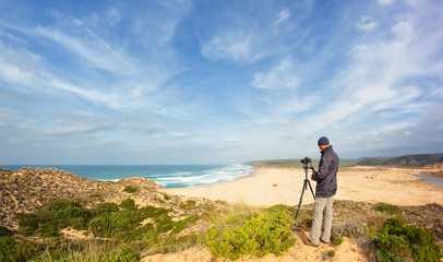 Male photographer traveling and photography in the dunes.
