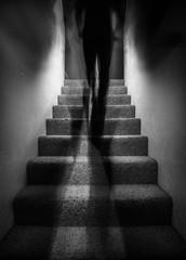 Shadow Figure Walking Up Stairs