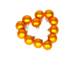 Heart shape of yellow Christmas balls