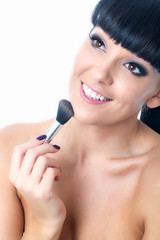 Young Woman Applying Face Powder
