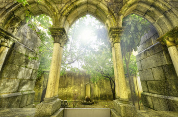 Ancient gothic arches in the myst. Fantasy landscape in Evora.