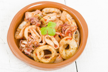 Fried Squid Rings - Pan fried squid rings with red pepper.