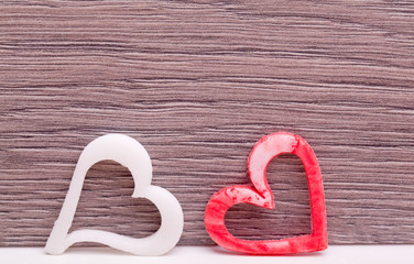 two fudge heart on wooden background